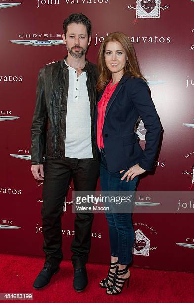 Darren Le Gallo and Amy Adams arrive at the 11th Annual John Varvatos Stuart House Benefit at John Varvatos on April 13 2014 in Los Angeles California