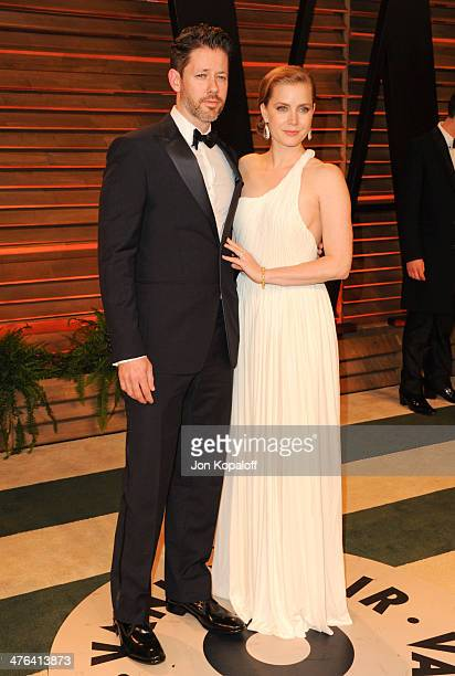 Darren Le Gallo and Amy Adams attend the 2014 Vanity Fair Oscar Party hosted by Graydon Carter on March 2 2014 in West Hollywood California