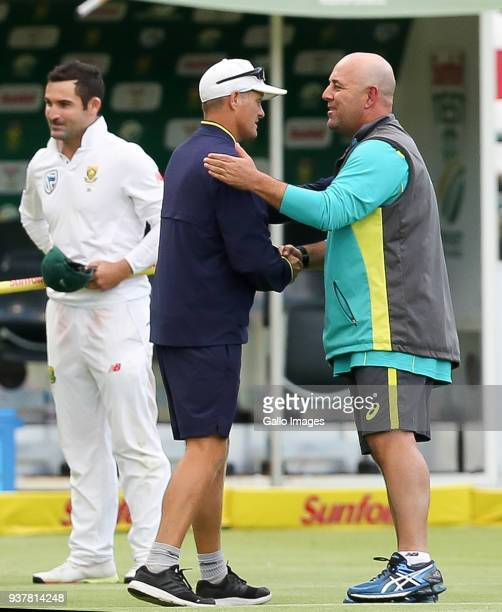 Darren Lehman shakes the hand of Dale Benkenstein during day 4 of the 3rd Sunfoil Test match between South Africa and Australia at PPC Newlands on...