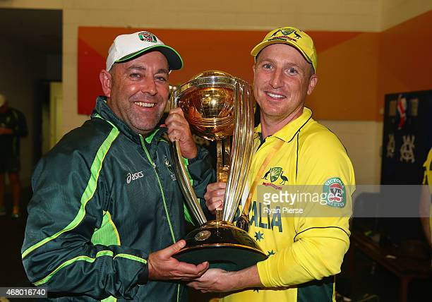 Darren Lehmann coach of Australia and Brad Haddin of Australia celebrate with the trophy during the 2015 ICC Cricket World Cup final match between...