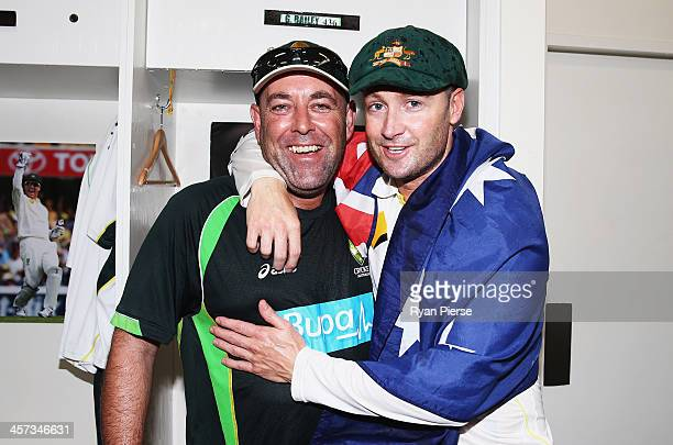 Darren Lehmann coach of Australia and Michael Clarke of Australia celebrate victory in the change rooms during day five of the Third Ashes Test Match...