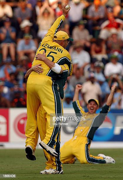 Darren Lehmann is lifted up after taking the last catch and Australian captain Ricky Ponting sinks to his knees to celebrate winning the World Cup...
