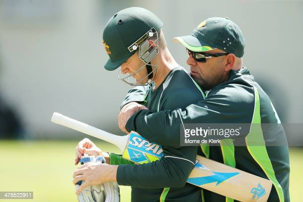 Darren Lehmann of Australia speaks to Michael Clarke during an Australian nets session at Newlands Stadium on February 28 2014 in Cape Town South...