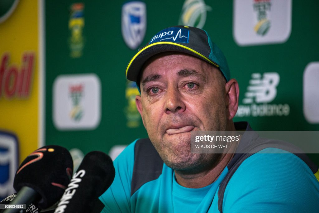 TOPSHOT - Darren Lehmann speaks to the press as he announces he will resign as Australian cricket coach after the coming Test match on March 29, 2018 in Johannesburg. /