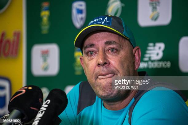 TOPSHOT Darren Lehmann speaks to the press as he announces he will resign as Australian cricket coach after the coming Test match on March 29 2018 in...