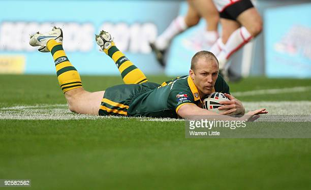 Darren Lockyer captain of Australia dives over to score a try during the Gillette Four Nations match between England and Australia at DW Stadium on...