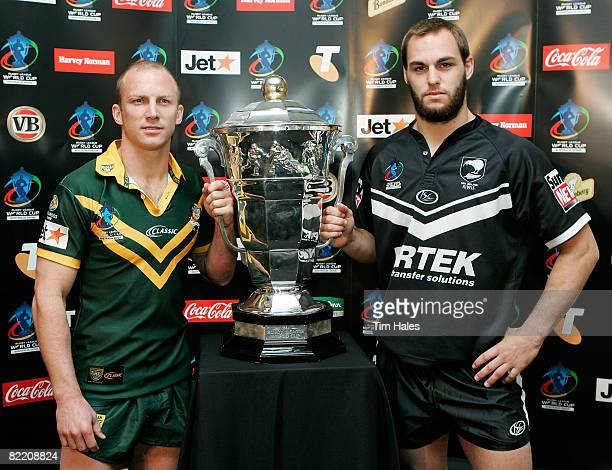 Darren Lockyer captain of the Australian Kangaroos and Simon Mannering of the New Zealand Kiwis pose with the Rugby League World Cup trophy a Rugby...