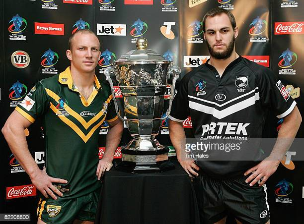 Darren Lockyer captain of the Australian Kangaroos left and Simon Mannering of the New Zealand Kiwis pose with the Rugby League World Cup trophy...