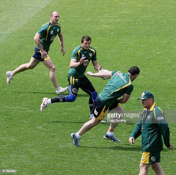 Darren Lockyer Josh Morris Paul Gallen and Kangaroos coach Tim Sheens are seen during an Australian Kangaroos training session at Concord Oval on...
