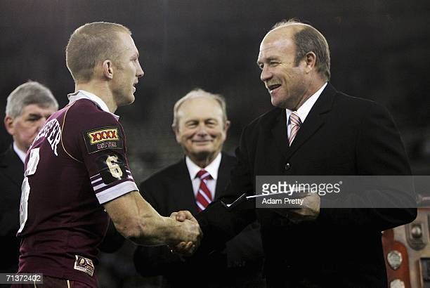 Darren Lockyer of Queensland is given the Wally Lewis medal by Wally Lewis after victory in the match between the New South Wales Blues and...