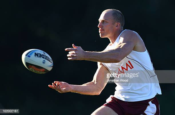 Darren Lockyer of Queensland passes during a Queensland Maroons Origin training session at the Hyatt Resort Coolum on June 12 2010 on the Sunshine...