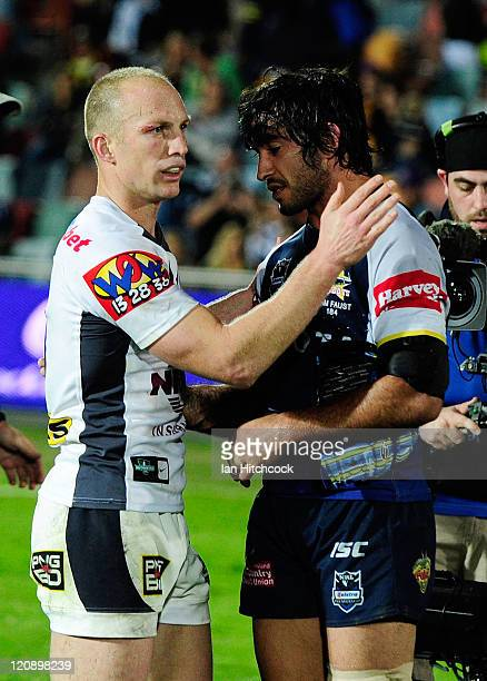 Darren Lockyer of the Broncos and Johnathan Thurston of the Cowboys congratulate each other at the end of the round 23 NRL match between the North...