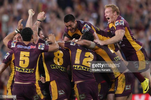 Darren Lockyer of the Broncos and team mates celebrate victory after kicking the winning field goal in gold point extra time during the NRL second...