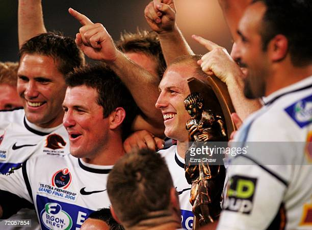 Darren Lockyer of the Broncos and team mates celebrate winning the NRL Grand Final between the Brisbane Broncos and the Melbourne Storm at Telstra...