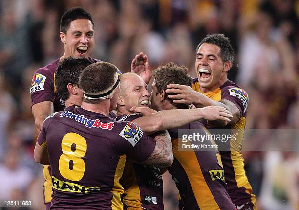 Darren Lockyer of the Broncos celebrates victory with team mates after kicking the winning field goal in gold point extra time during the NRL second...