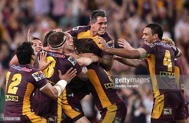 Darren Lockyer of the Broncos celebrates with team mates after kicking the winning field goal in golden point extra time during the NRL second semi...