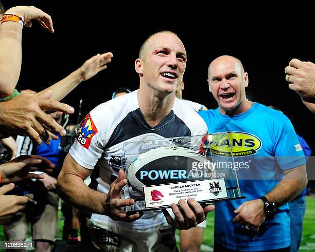 Darren Lockyer of the Broncos comes off the field through a team honour guard at the end of the round 23 NRL match between the North Queensland...