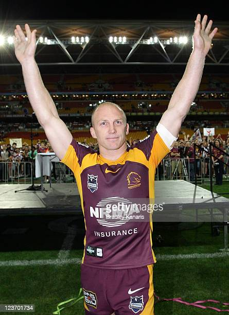 Darren Lockyer of the Broncos farewells fans in his last home match during the round 26 NRL match between the the Brisbane Broncos and the Manly Sea...