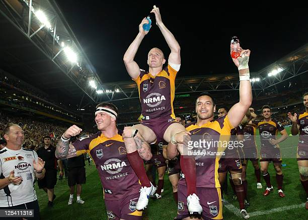 Darren Lockyer of the Broncos is chaired from the field in his final match in Brisbane after the NRL second semi final match between the Brisbane...