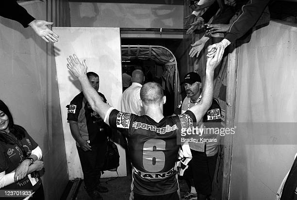 Darren Lockyer of the Broncos leaves the field as he farewells fans in his last regular season home game during the round 26 NRL match between the...