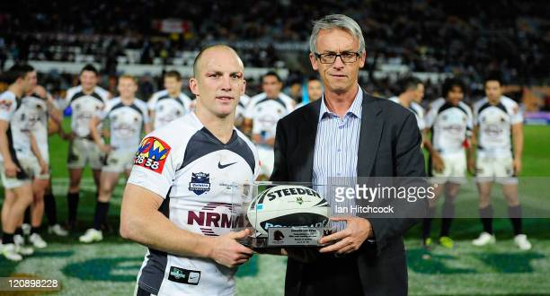 Darren Lockyer of the Broncos poses with NRL CEO David Gallop after playing his 350th match at the end of the round 23 NRL match between the North...