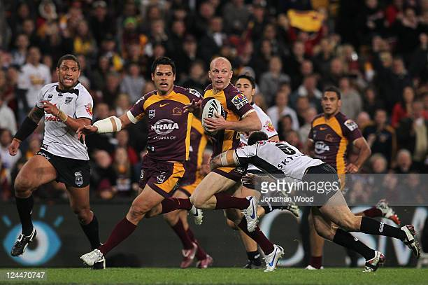 Darren Lockyer of the Broncos runs in attack during the NRL 2nd Qualifying Final match between the Brisbane Broncos and the Warriors at Suncorp...
