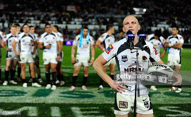 Darren Lockyer of the Broncos speaks to the crowd after playing his 350th NRL match at the end of the round 23 NRL match between the North Queensland...