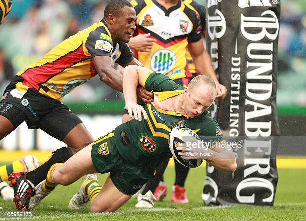 Darren Lockyer of the Kangaroos scores a try during the Four Nations match between the Australian Kangaroos and Papua New Guinea at Parramatta...