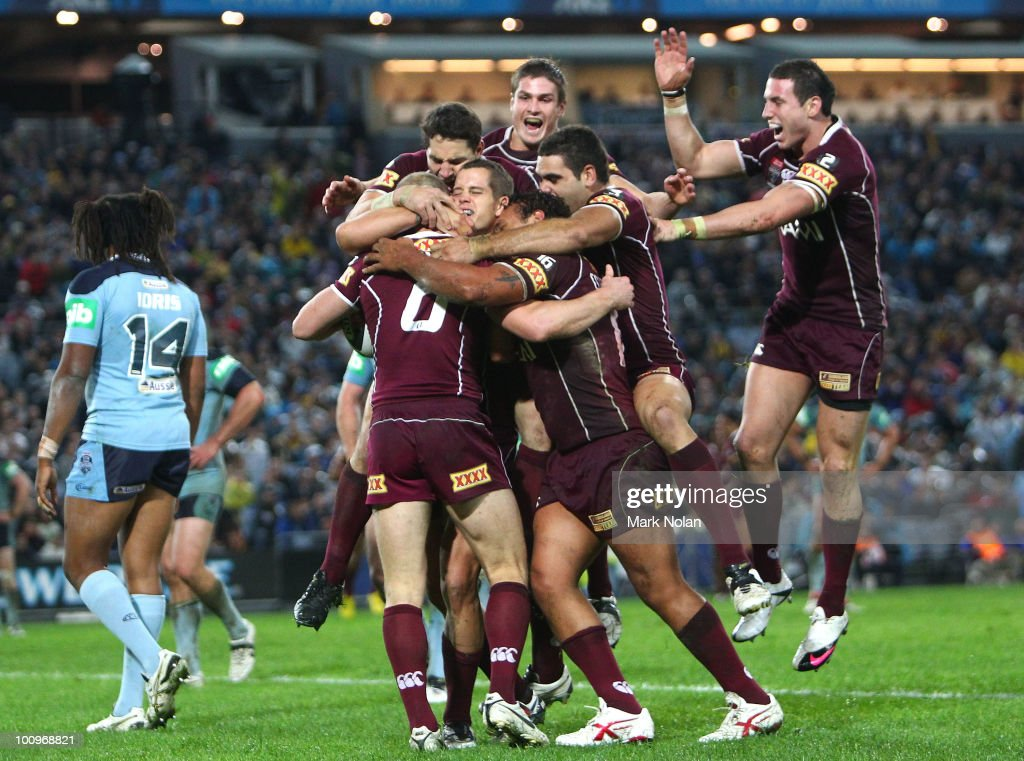 Darren Lockyer #6 of the Maroons celebrates with team mates after scoring a try during game one of the ARL State of Origin series between the New South Wales Blues and the Queensland Maroons at ANZ Stadium on May 26, 2010 in Sydney, Australia.