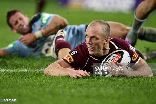 Darren Lockyer of the Maroons dives over to score a try during game one of the ARL State of Origin series between the New South Wales Blues and the...