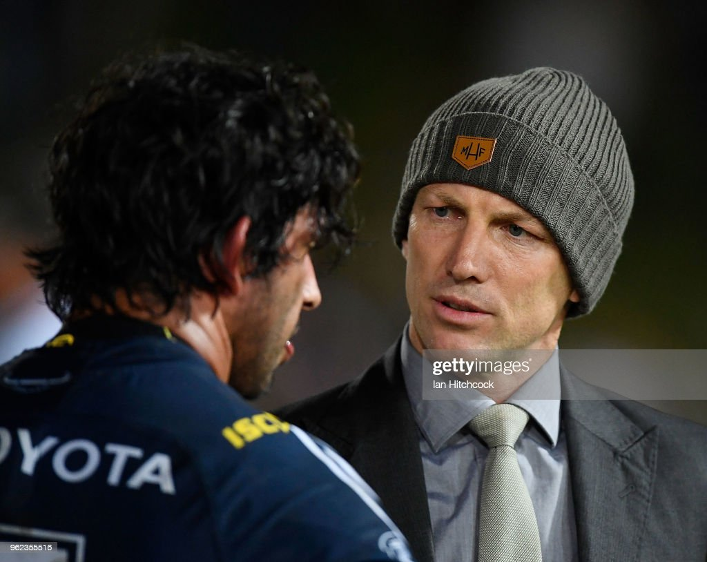 Darren Lockyer speaks with Johnathan Thurston of the Cowboys at the end of the round 12 NRL match between the North Queensland Cowboys and the Melbourne Storm at 1300SMILES Stadium on May 25, 2018 in Townsville, Australia.