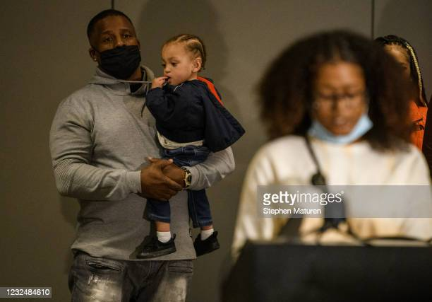 Darren Logan , Chyna Whitaker's step father, holds her son Daunte Wright Jr. During a press conference on April 23, 2021 in Minneapolis, Minnesota....