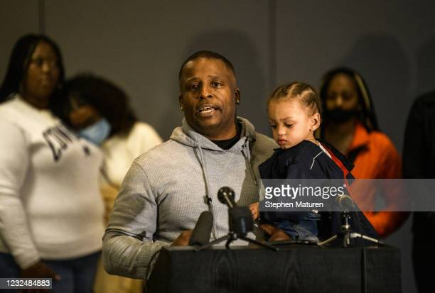 Darren Logan , Chyna Whitaker's step-father, holds her son Daunte Wright Jr. , as he speaks during a press conference on April 23, 2021 in...
