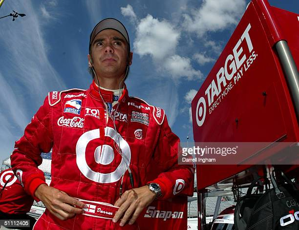 Darren Manning driver of the Target Chip Ganassi Racing Toyota GForce looks on during practice for the Indy Racing League IndyCar Series Menards AJ...