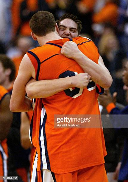Darren Mastropaolo of the Bucknell Bison embraces Chris McNaughton seconds after his team upset the Kansas Jayhawks during the first round of the...