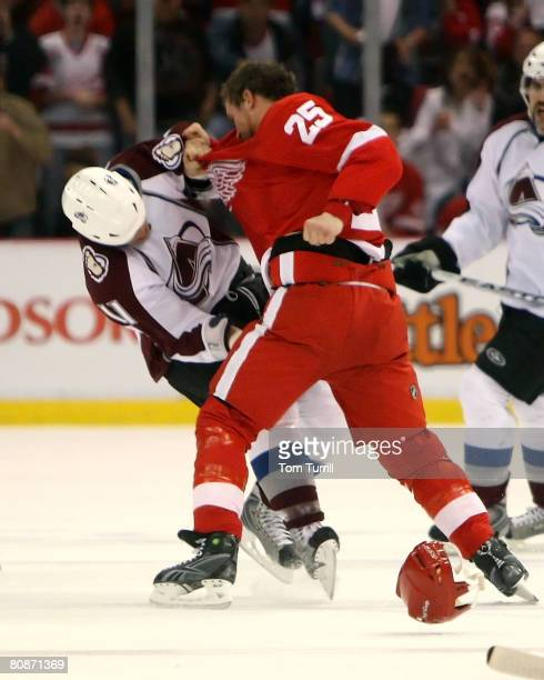 Darren McCarty of the Detroit Red Wings and Cody McCormick of the Colorado Avalanche fight during game two of the Western Conference Semifinals of...