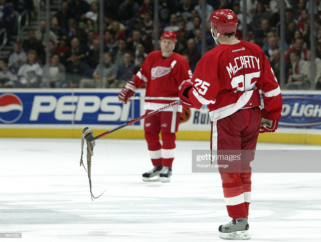Red wings v kings photos and images getty images darren mccarty 25 of the detroit red wings lifts an octopus that a spectator threw voltagebd Images