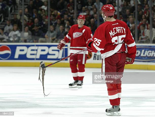 Darren McCarty of the Detroit Red Wings lifts an octopus that a spectator threw on the ice after Ziggy Palffy of the Los Angeles Kings scored the...