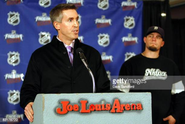 Darren McCarty of the Detroit Red Wings looks on as NHL EVP of Marketing Brian Jennings talks about NHL FaceOff Rocks to the media in a press...