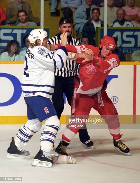 Darren McCarty of the Detroit Red Wings skates against Ken Baumgartner of the Toronto Maple Leafs during NHL preseason game action on October 1 1995...