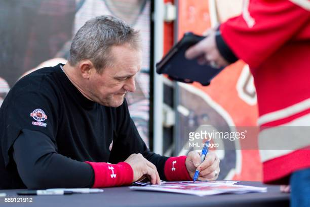 Darren McCarty signs autographs during the NHL Centennial Fan Arena on December 3 2017 in Detroit Michigan