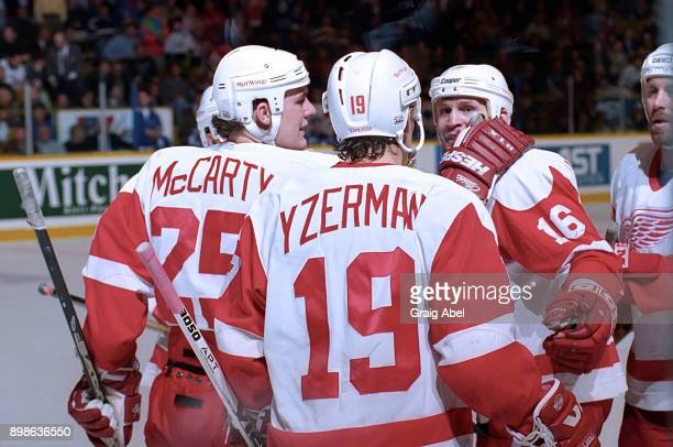 Darren McCarty Steve Yzerman and Vladimir Konstantinov of the Detroit Red Wings celebrate their win over the Toronto Maple Leafs during NHL game...