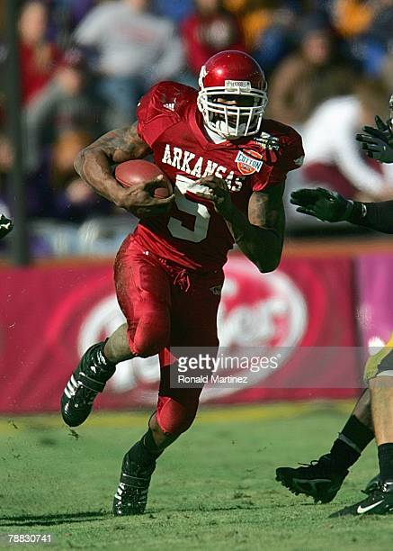 Darren McFadden of the Arkansas Razorbacks carries the ball against the Missouri Tigers during the ATT Cotton Bowl Classic on January 1 2008 at the...