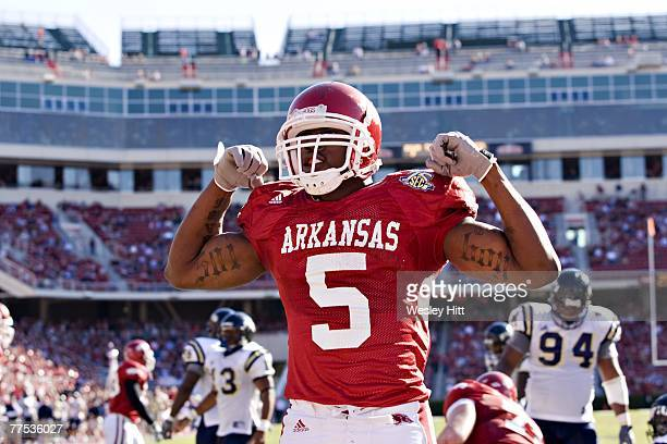 Darren McFadden of the Arkansas Razorbacks does his 501 pose after scoring a touchdown against the Florida International Golden Panthers at Donald W...