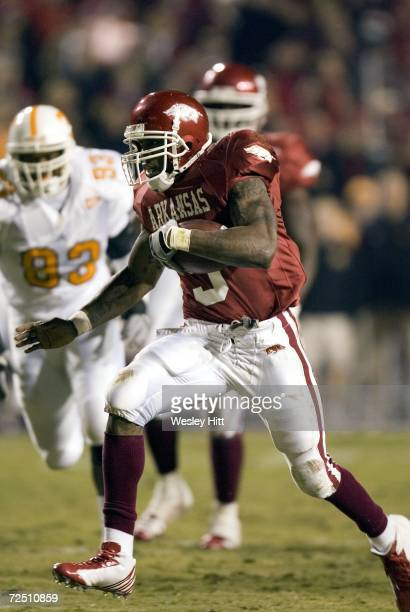 Darren McFadden of the Arkansas Razorbacks runs with the ball against the Tennessee Volunteers at Donald W Reynolds Stadium on November 11 2006 in...