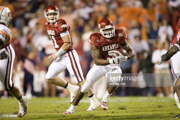 Darren McFadden of the Arkansas Razorbacks runs with the ball against the Auburn Tigers at Donald W Reynolds Stadium on October 13 2007 in...