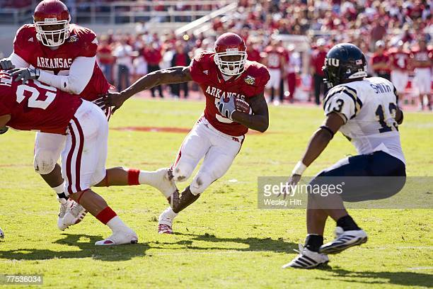 Darren McFadden of the Arkansas Razorbacks runs with the ball against the Florida International Golden Panthers at Donald W Reynolds Stadium October...