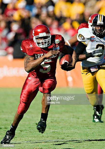 Darren McFadden of the Arkansas Razorbacks runs with the ball against the Missouri TIgers at The Cotton Bowl on January 1, 2008 in Dallas, Texas. The...
