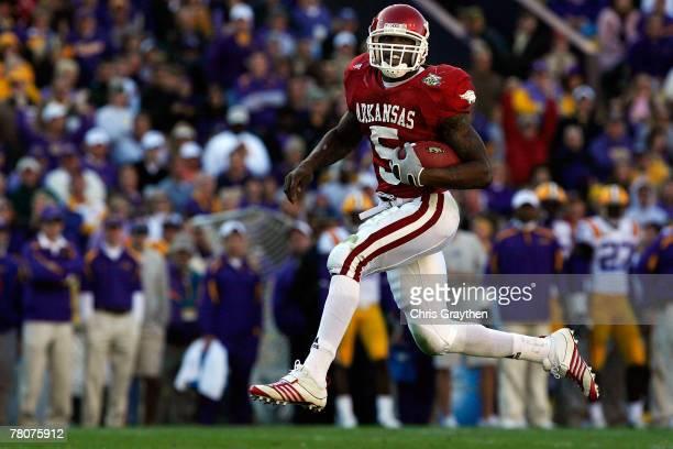 Darren McFadden of the Arkansas Razorbacks scores a touchdown against the Louisiana State University Tigers on November 23, 2007 at Tiger Stadium in...