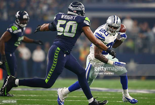 Darren McFadden of the Dallas Cowboys loses his grip on an incomplete pass against KJ Wright of the Seattle Seahawks in the first quarter at ATT...